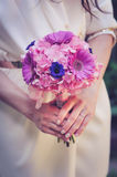 Bride holding wedding flowers Royalty Free Stock Photography
