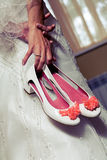 Bride holding wedding shoes Royalty Free Stock Image