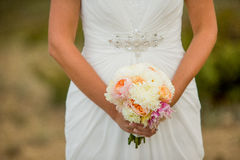 Bride holding bouquet of white flowers Stock Images