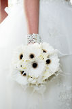 Bride Holding white flowers Royalty Free Stock Photo