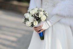 Bride holding white wedding bouquet.  Stock Images