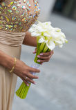 Bride holding white wedding bouquet Stock Photo