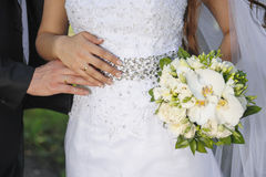 Bride holding white wedding bouquet of roses and love flower.  Stock Image