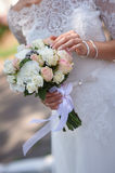 Bride holding white wedding bouquet of roses and love flowers.  Royalty Free Stock Photos