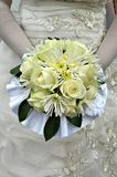 Bride holding yellow bouquet stock image