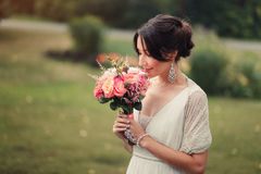 Bride holds boho wedding bouquet stock images