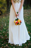 Bride holds a bouquet Stock Photo