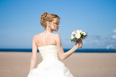 Bride holds bouquet Royalty Free Stock Photos