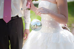 Bride holds disco ball Royalty Free Stock Photos