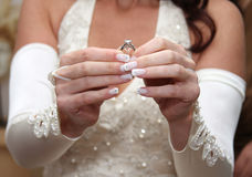 Bride holds engagement ring Royalty Free Stock Images
