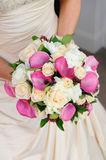 Bride holds flowers. Bride holding her vibrant and colourful flowers Stock Photo
