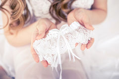 The bride holds the garter. Stock Photo