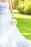 Bride holds in hand a wedding bouquet of flowers in a garden Stock Images