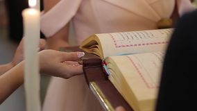 Bride holds holy bible in church on wedding ceremony stock video