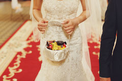 Bride holds a little basket with sweets Royalty Free Stock Images
