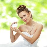 Bride holds out card outdoor Stock Photos