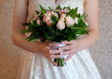 Soft and tender bridal bouquet of roses stock photos