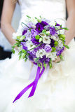 Bride holds the wedding bouquet Stock Photography