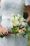 Bride holds a wedding bouquet Stock Photo
