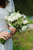 Bride holds a wedding bouquet Royalty Free Stock Images