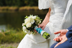 Bride holds a wedding bouquet Stock Image