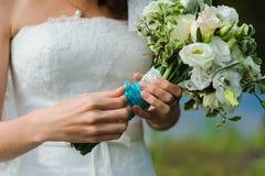 Bride holds a wedding bouquet Stock Photos