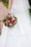 Bride holds wedding bouquet of flowers Royalty Free Stock Images