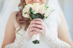 The bride holds Royalty Free Stock Images