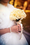 Bride Holds a Wedding Bouquet in Hands Royalty Free Stock Photography