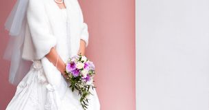 The bride holds a wedding bouquet of roses and orchids phalaenopsis stock images