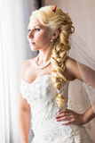 Bride with horns of the devil for Halloween Stock Image