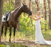Bride and horse Royalty Free Stock Photos