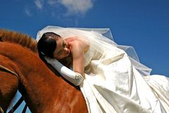 Bride on horseback Royalty Free Stock Photos