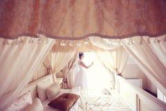 Bride in a hotel room Stock Photo