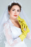 Bride with household gloves Royalty Free Stock Image