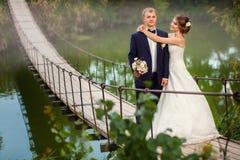 Bride hugging groom on bridge Royalty Free Stock Photography