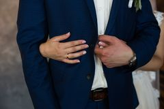 The bride hugging the groom. Hands of married couple with golden rings. Love Stock Photo