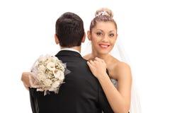 Bride hugging the groom Royalty Free Stock Photo