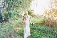 Free Bride In White Dress With A Bouquet Is Walking Along. Royalty Free Stock Photography - 123201837