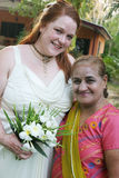 Bride and Indian woman Royalty Free Stock Photo