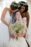 Bride interacting with bridesmaid at home. Smiling bride interacting with bridesmaid at home Royalty Free Stock Photography