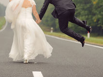 Bride and Jumping Groom Stock Image