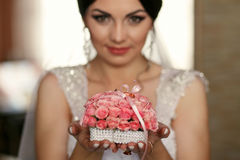 The bride keeps a bouquet with rings Stock Photography