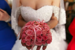 The bride keeps a bouquet with rings Stock Images