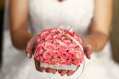 The bride keeps a bouquet with rings Stock Photos