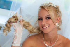 Bride keeps hair Royalty Free Stock Images