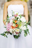 The bride keeps her wedding bouquet Royalty Free Stock Photo