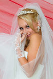 Bride keeps veil. Bride keeps his hands on his chest and looks toward. Close-up, soft focus royalty free stock image