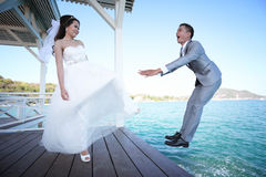 Bride kicking a Bridegroom,Pre Wedding photography thai couples. At Koh Si Chang Island concept in memory of love Royalty Free Stock Image