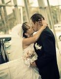 Bride kissing groom Royalty Free Stock Photo